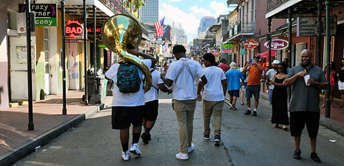 4-piece jazz band plays as they move along Bourbon Street