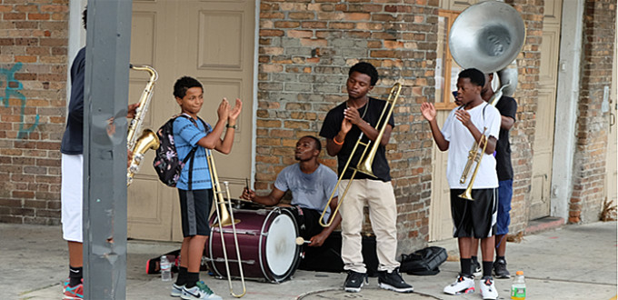 6 young men play jazz on a French Quarter street corner